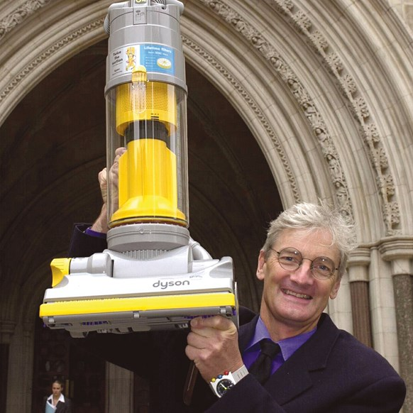 James Dyson with DC01 vacuum cleaner outside court